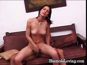 Naughty shemale is on the couch getting her both holes fucked so deep down